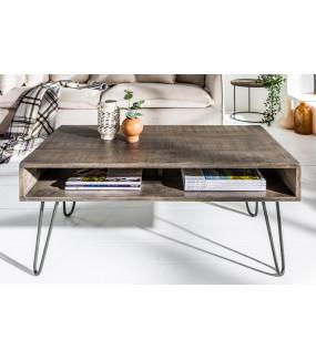 Praktyczny stolik kawowy z drewna mango do pokoju w stylu industrialnym.