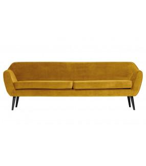 Sofa w żółtym kolorze do salonu w stylu retro. Sprawdzi się w nowoczesnym pokoju.