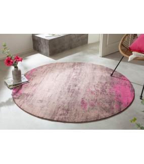 Okrągły dywan MODERN ART w kolorze różowym idealny do pokoju w stylu nowoczesnym lub salonu w stylu retro.