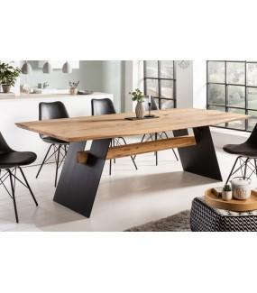Stół dębowy z ozdobną belką idealny do industrialnego salonu lub skandynawskiej jadalni.