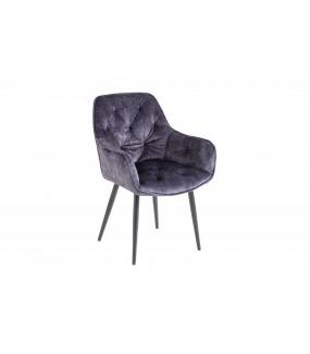 Wygodne krzesło tapicerowane w stylu chesterfield do salonu w stylu glamour. Sprawdzi się w pokoju dziennym