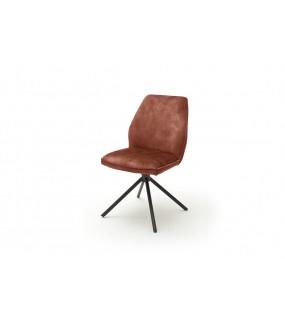 Krzesło tapicerowane w optyce weluru świetnie sprawdzi się w salonie w stylu industrialnym.